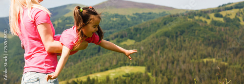 Mother and daughter playing circling around in the mountains on beautiful Canvas Print