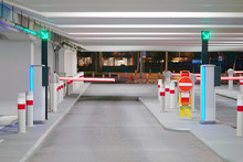 Barrier At Entrance And Exit Of A Car Parking Garage. Barrier In A Car Park. Exit From Underground Parking. Underground Parking/garage. Interior Of Parking