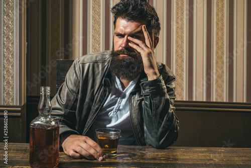 Fényképezés  Man with beard holds glass brandy