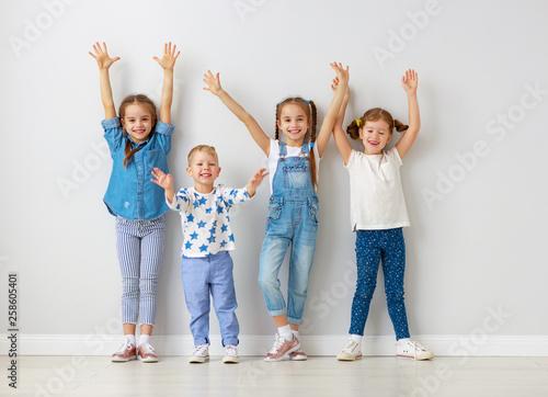happy kids friends around empty walls. Wallpaper Mural