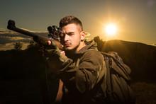Hunter With Shotgun Gun On Hun...