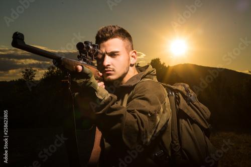 Canvas Print Hunter with shotgun gun on hunt
