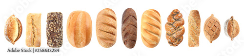 Photo Set of fresh bread on white background, top view