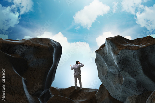 Businessman fallen to the gap in mountains Canvas-taulu
