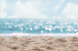 canvas print picture - Seascape abstract beach background. blur bokeh light of calm sea and sky. Focus on sand foreground.