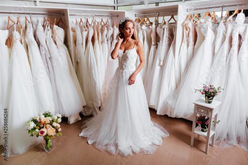 Slika na platnu Female trying on wedding dress in a shop