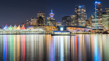 Vancouver, British Columbia, Canada. Long Exposure At Night Over BC Place With Downtown In The Background.
