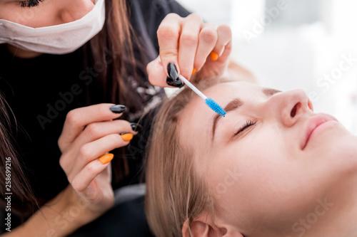 Fotografie, Obraz  Pretty girl getting brow depilation at beauty salon