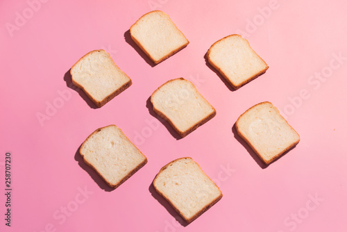 Fotografering Sliced bread to toast isolated on pink background