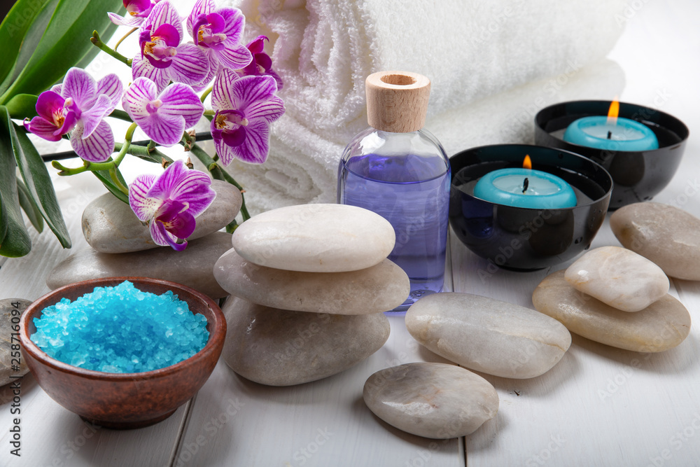 Fototapety, obrazy: composition of the spa treatment. Candles in bowls with water, bath salts, and orchid flowers.