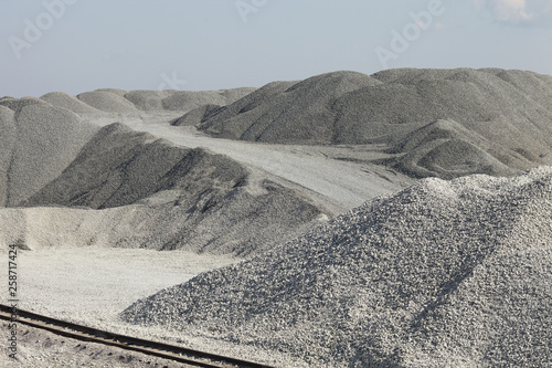 Piles of limestone rocks with the railroad in the foreground Canvas Print