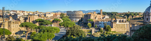 Fotografiet Scenic panorama of Rome with Colosseum and Roman Forum, Italy.