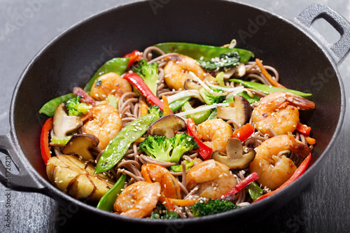 Stir fried noodles with shrimps and vegetables in a wok Wallpaper Mural