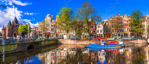 Romantic canalas of Amsterdam. Travel in Holland Canvas Print