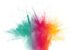 Multicolored powder explosion on white background.Launched colorful particles on background.