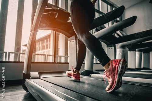 Close up on shoe,Women running in a gym on a treadmill Fototapeta