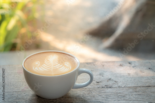 Recess Fitting Cafe Caffe latte art coffee with milk in white ceramic coffee cup on wooden table in coffee shop cafe restaurant with blurred morning sunlight nature backgrounds. Concept for coffee lover or relaxation