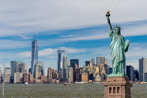 Fotografie, Obraz  The Statue of Liberty with One World Trade Center and Manhattan downtown financial district in background, Landmarks of New York City, New York skyscrapers at Lower Manhattan, New York City, USA