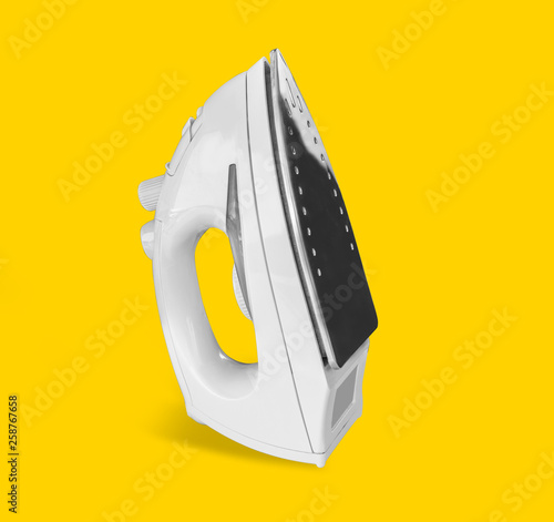 Fotografie, Obraz  Iron isolated on yellow background