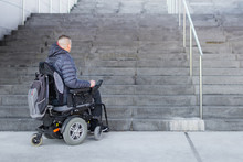 Disabled Man On An Electric Wheelchair Who Can't Get Up The Stairs