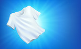 Bright white clean clothes, laundry on blue background