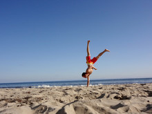 Man Does One Handed Handstand On Beach