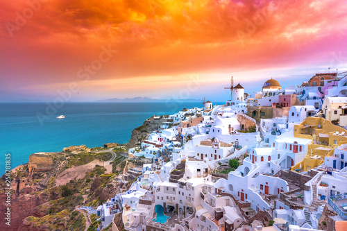 Fototapeta Oia town on Santorini island, Greece. Traditional and famous houses and churches with blue domes over the Caldera, Aegean sea obraz