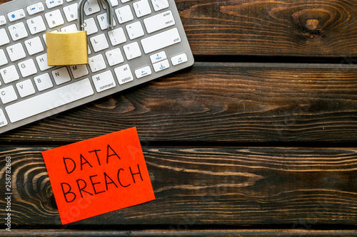Fotomural  data breach concept with locker on keyboard on wooden background top view mock u