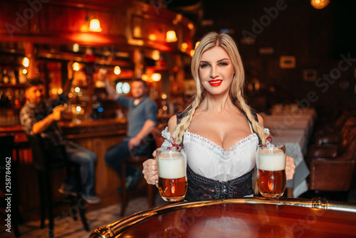 Sexy waitress with large breasts in pub Canvas Print