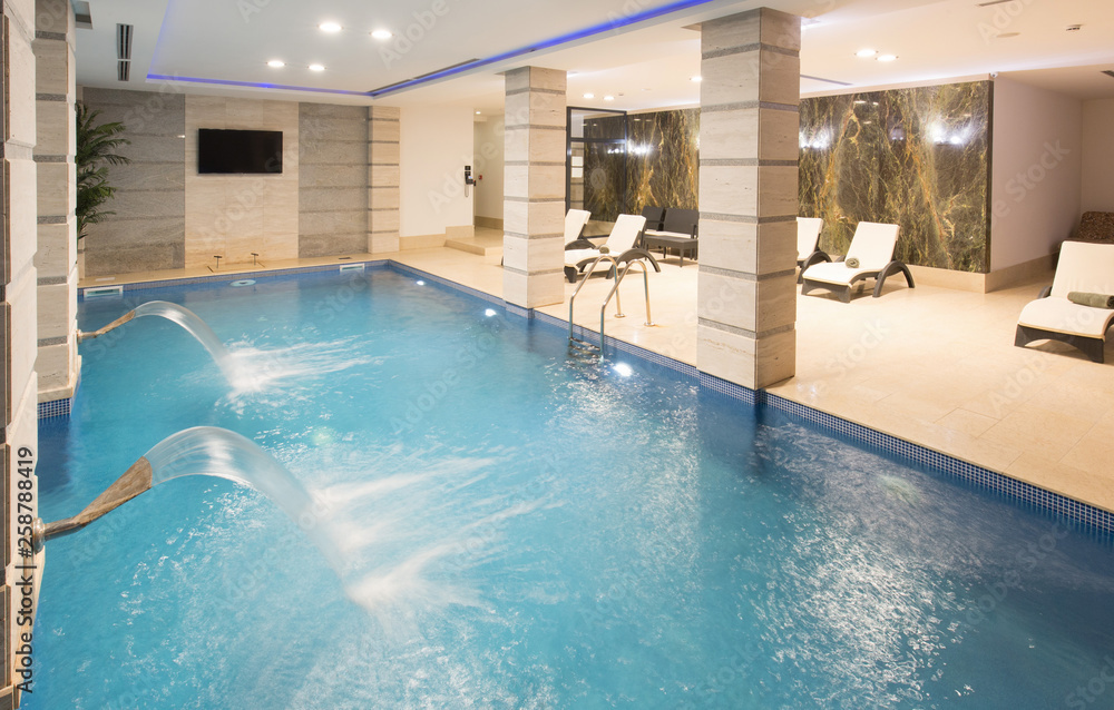 Fototapeta Swimming pool in hotel spa and wellness center