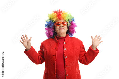 фотография Mature woman with a colorful wig