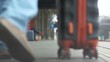 Close-up of the legs go along the platform of the railway station, a suitcase is being carried nearby. Transport and travel concept