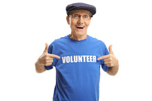 Cheerful Elderly Man Wearing A Volunteer Signed T-shirt And Pointing At It