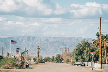 A Street And Mountains In Bombay Beach, On The Salton Sea In California