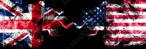 Obraz United Kingdom vs United States of America, American smoky mystic flags placed side by side. Thick colored silky smoke flags of Great Britain and United States of America, American. - fototapety do salonu