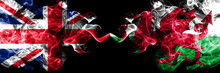 United Kingdom Vs Wales, Welsh Smoky Mystic Flags Placed Side By Side. Thick Colored Silky Smoke Flags Of Great Britain And Wales, Welsh.