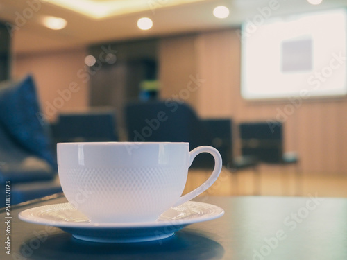 Photo  The white coffee cup on the table in meeting room.