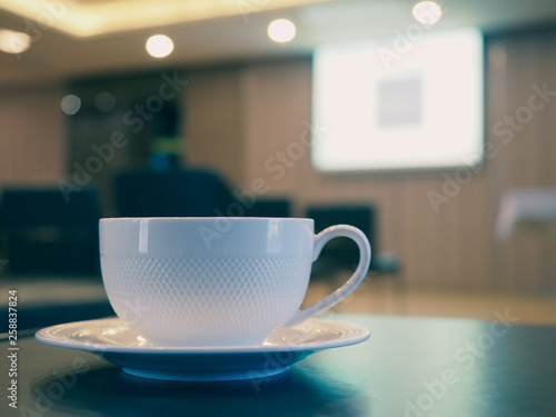 The white coffee cup on the table in meeting room. Canvas Print