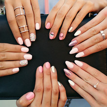Close Up Of Different Fashionable And Trendy Manicure With Design On Girl S Hands. Incognito Female Hands With Elegance Silver Rings Holding Black Leather Hand Bag. Concept Of Beauty And Manicure.
