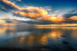 Fantastic Sunset Clouds over Ocean with Reflections