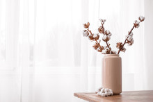 Vase With Cotton Branches On T...