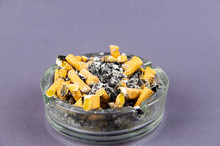 Overflowing Ashtray With Cigarette Butts And Ash