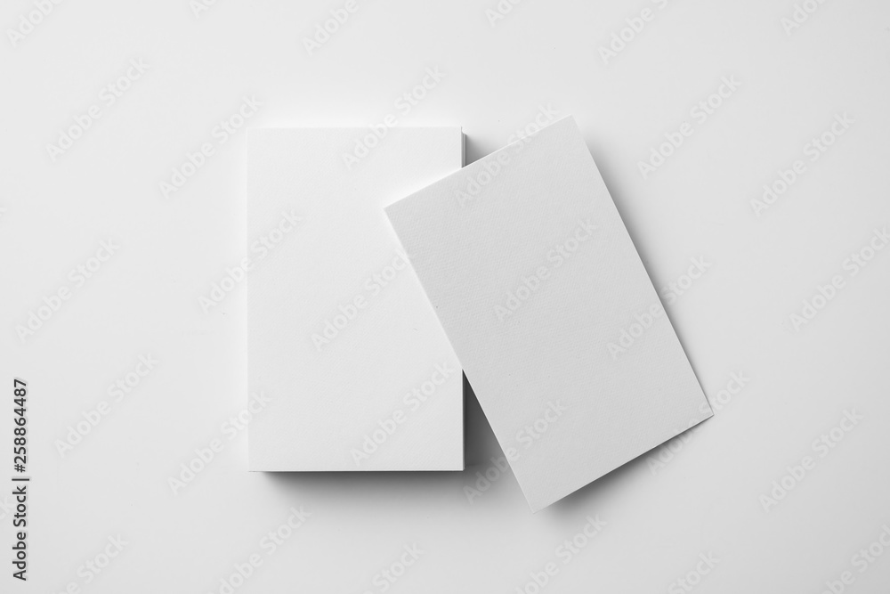 Fototapety, obrazy: top view of 2 business card isolated on white