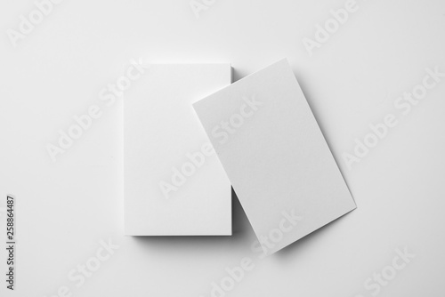 Fotografía  top view of 2 business card isolated on white