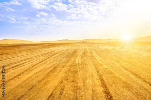 Fényképezés  Desert landscape sand dunes at sunset sky near Qatar and Saudi Arabia