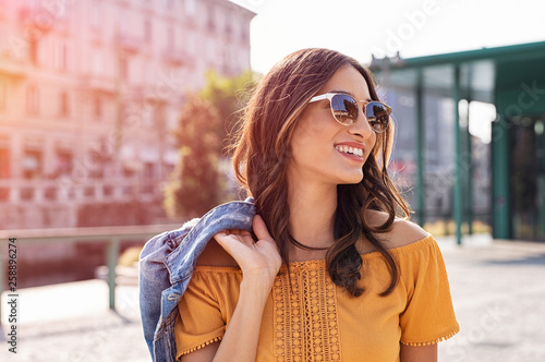 obraz PCV Young woman walking on street