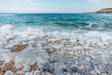 .incredibly Beautiful Seaside Of The Dead Sea With Blue Water And White Crystals Of Salt Near.selective Focus