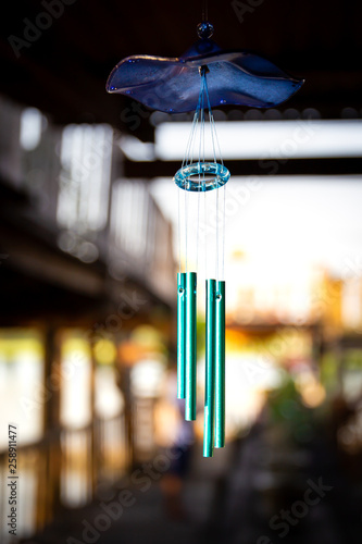 Wind bell hanging at front the door of traditional residential in Asia close up. Wall mural