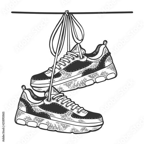Fotografía  Sneakers are hanging on wire sketch engraving vector illustration