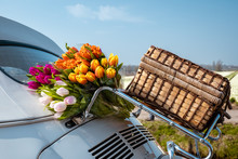 Tulip Flowers On The Backside Of An Classic Car With Luggage Bag